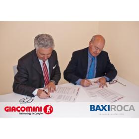 firma del acuerdo entre giacomini y baxi roca