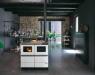 Cocina de pellets por agua Bella de Palazzetti: calefacción para el hogar y cocción con leña